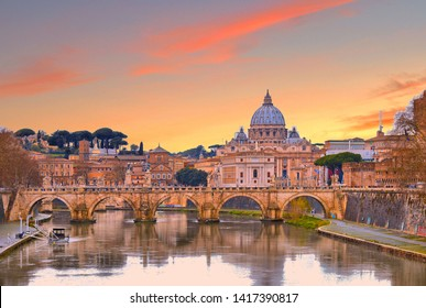 cityscape and panoramic view of old bridge with warm sunset sky water reflections and dome of St. Peters cathedral church with old buildings and architecture in Rome, Italy