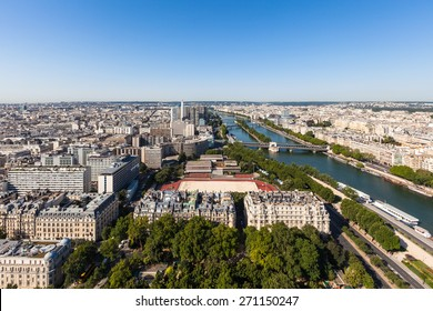 Cityscape of Paris with aerial view from Eiffel tower - the Seine river and residential buildings in morning sunshine