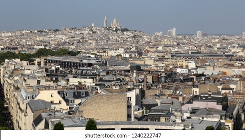 Cityscape of Paris, France, with the Sacre-coeur church in the distance