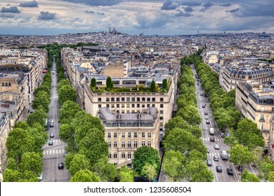 Cityscape of Paris, France, with tree-lined boulevards and the Sacre-coeur church on the Montmartre hill