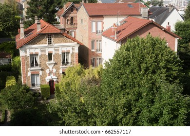 Cityscape of Paris and little houses