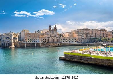 Cityscape with Parish Church in Balluta bay. St Julian's, Malta