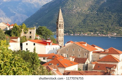 Cityscape of Perast on coast of Boka Kotor bay. Montenegro. Adriatic sea. Roofs of old houses in Perast. Beautiful mediterranean landscape.