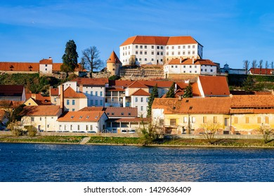 Cityscape of Ptuj Castle with old town at Drava River in Slovenia. Architecture in Slovenija. Travel