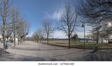 cityscape with public park at touristic historical village on shore of Verbano lake, shot in bright winter light at Angera, Verbano, Varese, Lombardy, Italy