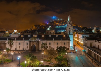 The cityscape of Quito at night with a view over the Plaza Grande (Main Square), the cathedral with its white tower and the Panecillo hill with the Virgin of Quito, Ecuador, South America.