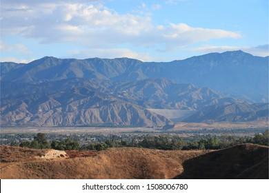 Cityscape of Redlands and Highland, California taken from Panorama Drive, Redlands. San Bernardino National Forest. San Bernardino Mountains. San Gorgonio Mountains. Santa Ana River. Seven Oaks Dam