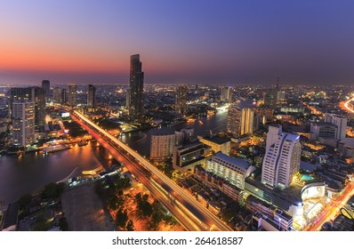 Cityscape of River in Bangkok city with high office building in night time