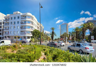 Cityscape with road traffic and Habib Bourguiba avenue with modern buildings. Tunis, Tunisia, North Africa