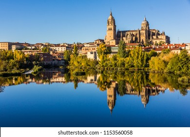 Cityscape of Salamanca and its mirror image on Tormes river (Spain)