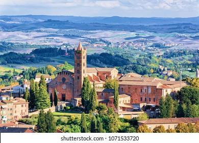 Cityscape with Santa Maria dei Servi Church in the old city of Siena, Tuscany, Italy