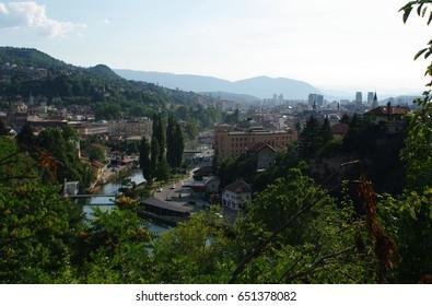 Cityscape of Sarajevo (High Angle View): Miljacka River & City Hall (Vijecnica) - Bosnia and Herzegovina