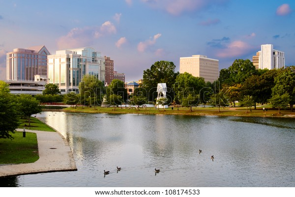 Cityscape scene of downtown Huntsville, Alabama, from Big Spring Park at sunset