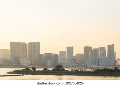 Cityscape and sea in sunset at odaiba. Building and skyscraper in city.