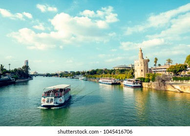 Cityscape of Seville with the Guadalquivir river, the Torre del Oro and the Torre Sevilla.