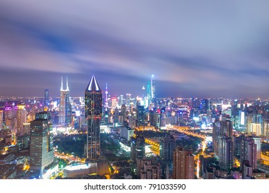 cityscape of shanghai in cloud sky at twilight from high angle view