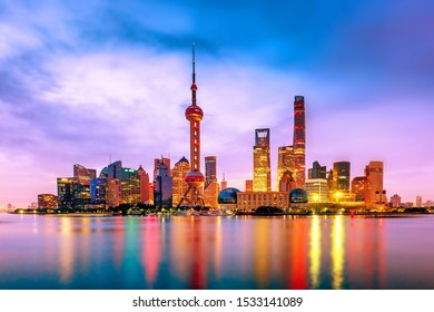 Cityscape of Shanghai at twilight sunset. Panoramic view of Pudong business district skyline from the Bund