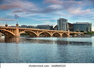 Cityscape shore view of downtown Tempe Arizona USA over the Salt River and Mill Avenue Bridge