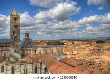 Cityscape of Siena, Italy with the tower of the cathedral on the left