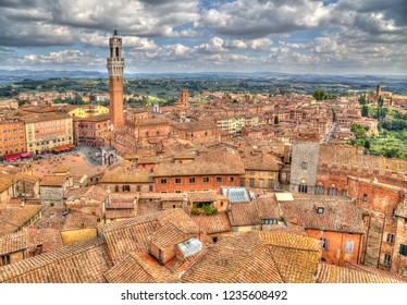 Cityscape of Siena, Italy with the tower of the city hall on the Piazza del Campo on the left