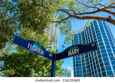 Cityscape sign view of the popular downtown area of Coconut Grove in Miami Dade County.