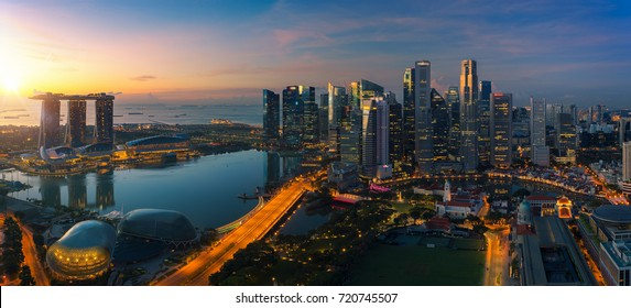 Cityscape of Singapore city sunrise and building in morning time, take photo from roof top bar in hotel