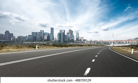 cityscape and skyline of chongqing from empty asphalt road