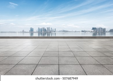 cityscape and skyline of hangzhou from empty brick floor