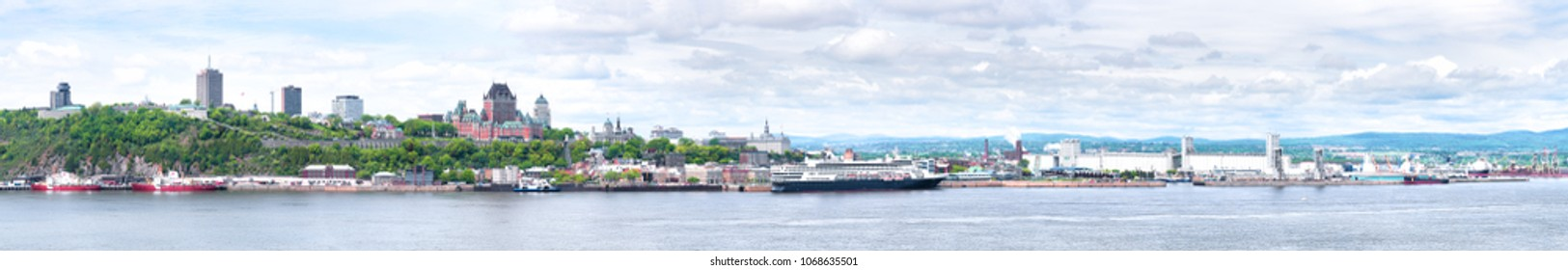 Cityscape and skyline panoramic panorama of Quebec City with Saint Lawrence river and boats