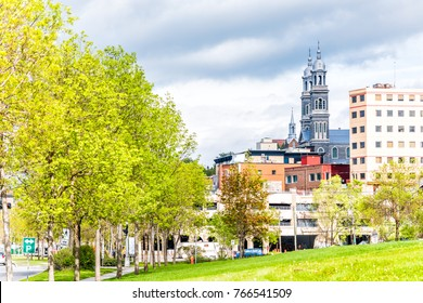 Cityscape or skyline of Saguenay city in Quebec, Canada with church, buildings, road