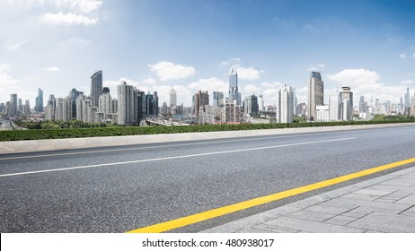 cityscape and skyline of shanghai from empty road