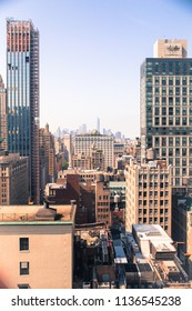 Cityscape skyline of various buildings, skyscrapers and architecture looking down on midtown Manhattan in New York City  towards downtowns Financial District