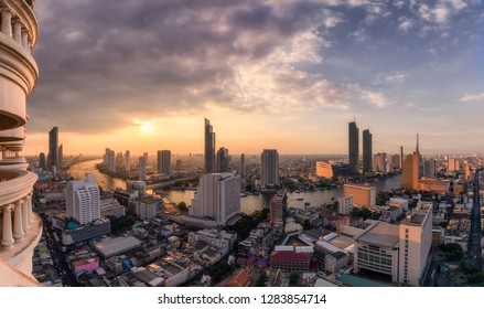 Cityscape of skyscraper with Chao Phraya river at sunset in Bangkok, Thailand