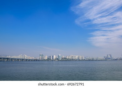 Cityscape, skyscrapers along the river with clear blue sky background, Seoul, Korea. Plenty of copy space