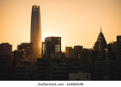 Cityscape with shinybuildings and skyscrapers in sunset time.