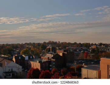 Cityscape of small historic city with partly cloudy skies