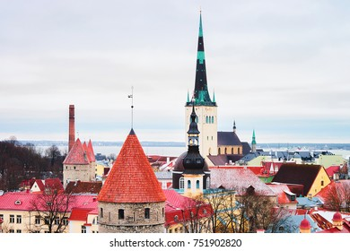 Cityscape with St Olaf Church and defensive walls at the Old town of Tallinn, Estonia in winter. View from Toompea hill