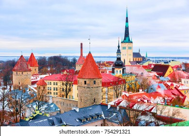 Cityscape with St Olaf Church and defensive towers at the Old town of Tallinn, Estonia in winter. View from Toompea hill