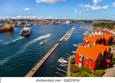 Cityscape of Stavanger, Norway under blue cloudy sky.