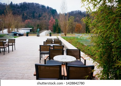 Cityscape with street cafe in the park in Celje old town in Slovenia. Architecture in Slovenija. Travel. Tables and chairs.