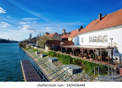Cityscape of street cafe at Ptuj Castle and old town at Drava River in Slovenia. Architecture in Slovenija. Travel