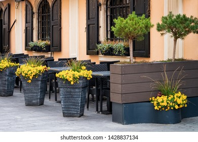 Cityscape with street cafes of Celje old town in Slovenia. Architecture in Slovenija. Travel. Tables and chairs.