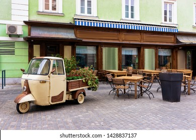 Cityscape with street cafes at Celje old town in Slovenia. Architecture in Slovenija. Travel. Tables and chairs.