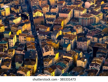 Cityscape structure background - town roofs and street. Modern town landscape, buildings of the city as urban texture background. Houses and rooftops of a big city.