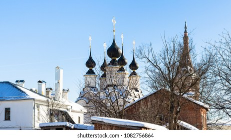 cityscape of Suzdal town with Church of Antipas, Bishop of Pergamon (Antipiev Church) and Church of Lazarus the Righteous Resurrection (Lazarevskaya Church) in winter in Vladimir oblast of Russia