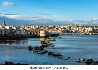 Cityscape of Syracuse (Siracusa) seen from the Ortygia Island (Isola di Ortigia) with the Mediterranean Sea. Sicily, Italy, South Europe