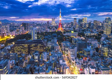 Cityscape of Tokyo, city aerial skyscraper view of office building and downtown and street of  minato in tokyo with sunset / sun rise background. Japan, Asia