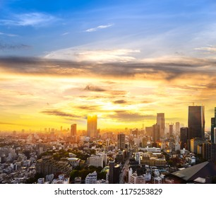 cityscape of tokyo city sunset skyline in Aerial view with skyscraper, modern business office building with yellow gold sky background in Tokyo metropolis city, Japan.
