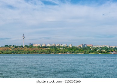 Cityscape of town Galati and its tall television tower highest building on Danube river from shore of Braila County, Romania