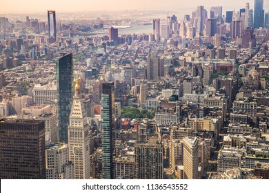 Cityscape of various buildings, skyscrapers, bridges and architecture looking down on midtown Manhattan in New York City  towards downtown